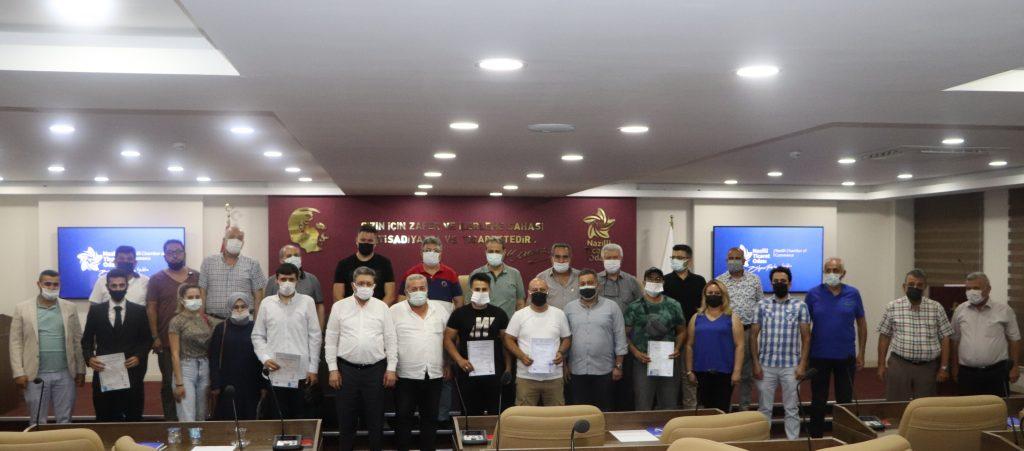 Sorumlu Emlak Danışmanları Mesleki Yeterlilik Belgelerini Nazilli Ticaret Odası Meclis Toplantısında Meclis Başkanı Gürdal Yüzügüler'den Teslim Aldılar